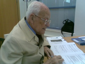 Charles completing a form to protest about building on Maghull's Green Belt.
