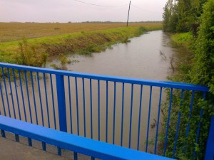 A very high Dovers Brook in 2012 next to cottages at Bridges Lane/Sefton Lane Maghull. The brook is the boundary between Maghull and Sefton Civil Parishes.