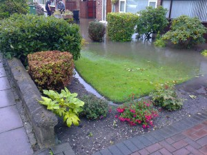 A flooded front garden in Fouracres where some folks had to leave their homes due to water getting inside their houses