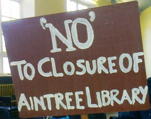 Sadly this placard could also read 'NO' to volunteers taking over Aintree Library!