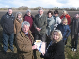 A petition being presented to Cllr. Dave Russell Chairman of Lydiate Parish Council next to a threatened Green Belt development site.