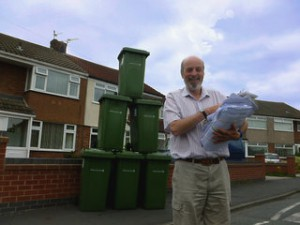 A green bin mountain, Cllr. Bruce Hubbard, and a huge pile of petitions opposing Labour's Green Bill tax for Sefton.