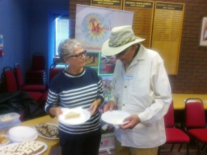 Ann Hill of Maghull in Bloom with Nigel Winchester of Maghull Station Volunteers enjoy a snack at the buffet that concluded the judges tour of Maghull.