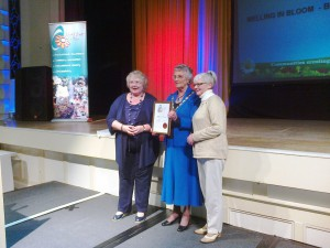 Doreen Scott (left of Mayor) of Melling in Bloom picked up an award in the Small Village category for Melling