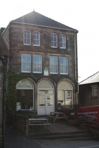 This is the grand looking former Co-op building in Youlgrave - now a YHA. The arched window panels give its history away