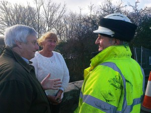 Lydiate Parish Cllrs. Dave Russell and Edie Pope discuss repair works with the construction manager.