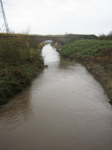 This is the River Alt as it flows under the A59 (Northway) on Maghull's southern boundary. In the background is the old Cheshire Lines Extension Railway bridge over the Alt which is now used as a footpath.