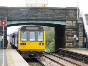 Burscough Bridge Station with a Manchester bound train from Southport.
