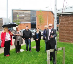 Barry's daughter Nickie is on the left of this shot with his Brother Graham next to the tree planted in Barry's name.