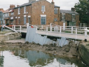 This is Bells Lane swing bridge with a makeshift dam in place to try to hold back the water. The houses by the bridge look significantly different now.