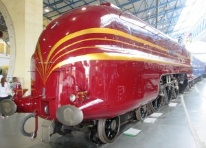 A trick of the light in the NRM gives the impression that the tender and coach behind the loco are blue - They are both LMS Crimson Lake just like the Duchess