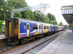 A Class 150 DMU on a Liverpool bound service with a 142 DMU in front of it.
