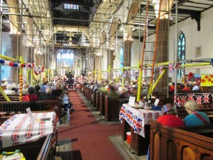 Prescot Parish Church, scaffolding and all, as Maghull Wind Orchestra do 'Last Night at the Proms'