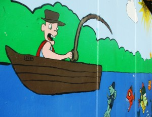 Mural on a concrete wall where The Strand Shopping Centre meets the Leeds Liverpool Canal.
