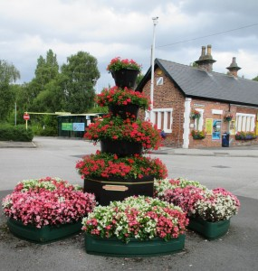 Beautiful award winning flower displays at Maghull Station by Maghull Station Volunteers.