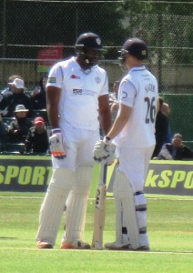 Derbyshire batsmen Chesney Hughes & Benjamin Slater meet in the middle to work out how to keep the Lancs bowlers out.