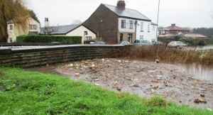 Dovers Brook where Sefton Lane becomes Bridges Lane - The houses were about to be inundated on 26th December 2015.