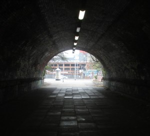This former railway tunnel once took a railway line under the Liverpool - Southport line at Bootle Strand Station. It is now a pedestrian walkway with the Strand Shopping Centre car park visible through it.