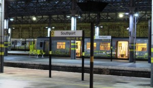 Southport Station at night with a 507/508 EMU awaiting to depart for Liverpool.