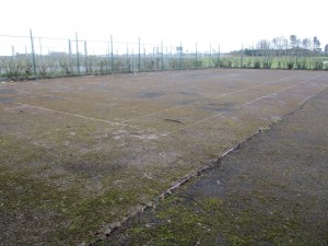 This is the present run-down condition of the Sandy Lane Park tennis courts surface.