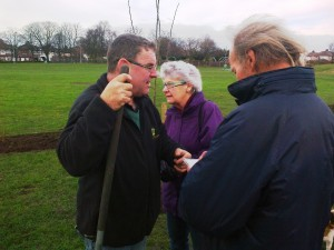 Jim (on the right) notebook in hand as always talking to Don Billington and Doreen Prescott of Maghull in Bloom - December 2013