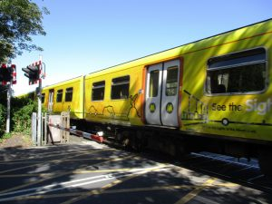 A present 507/508 EMU Merseyrail unit at Crescent Road level crossing - Birkdale, Southport.
