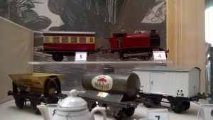 Hornby Tinplate O Gauge model railway items on display in the Childhood Room.