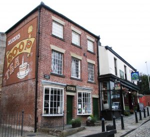 The Toad Lane Shop/Museum of Rochdale Pioneers with the Baum pub nextdoor