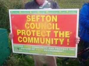 A protest placard demanding that Sefton Council takes notice of Formby views.